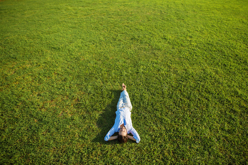 woman sleeping in grass